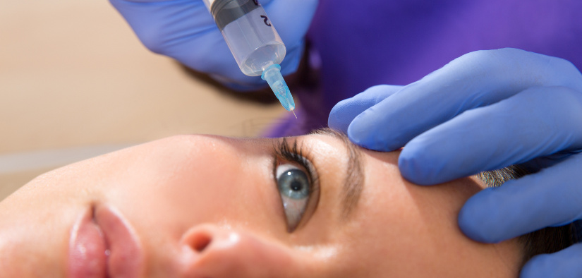 Anti aging facial mesotherapy with syringe closeup for face eye wrinkles