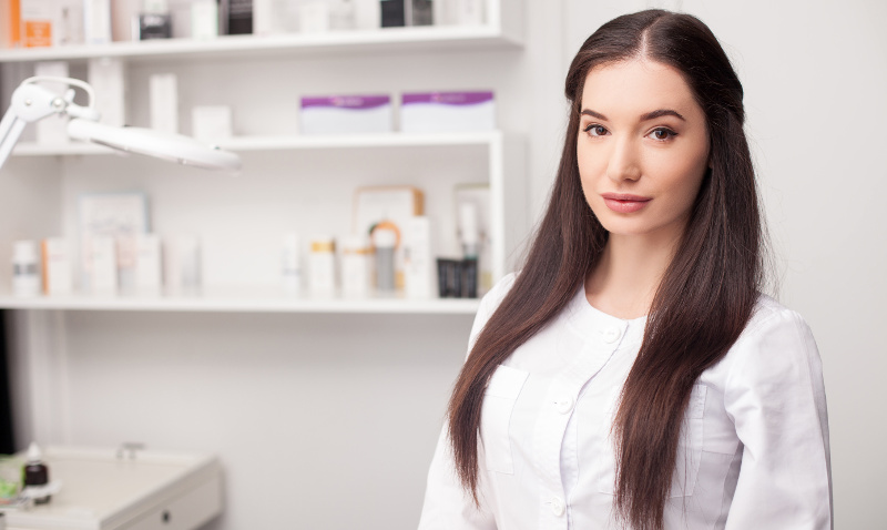 Attractive female expert beautician is waiting for customer