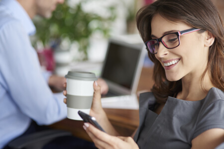 Drinking coffee and using mobilephone